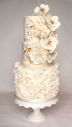 Sugar flower wedding cake with gold accents