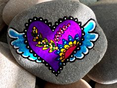A favorite from my Etsy shop https://www.etsy.com/listing/478385756/on-the-wingsof-love-painted-rocks