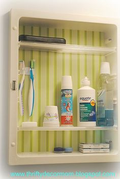 Medicine cabinet organization ideas with a colorful touch of contact paper.