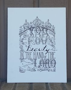 Isaiah 62:3a says You shall be a crown of beauty in the hand of the Lord. This verse is hand lettered in black ink on a canvas panel that