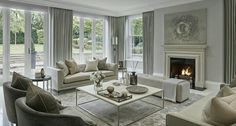 Again, beautiful wall to wall bank of floor to ceiling windows and doors.  Stunning.  Beautiful cream on cream colour scheme, classic styled furnishings, a beautiful cream based traditional carpet, and simple lines and understatement equals comfort, warmth, and timeless elegance.  Love it.