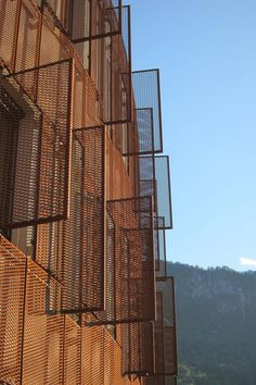 The Administrative Center from Jesenice as designed by Studio Kalamar has an exterior shell made of steel, in the very manufacturing tradition of Jesenice where many of the houses are rust – red, just like the oxidized façade of this center.