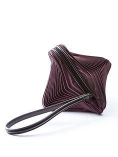 Metallic purple pleated 3D Meteorite Clutch with a leather handle by ISSEY MIYAKE. MADE IN JAPAN. Item ID: 11696769 Composition: 100% Polyurethane