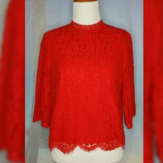 RED LACE BLOUSE Size 4. Red. Lace. 3/4 sleeve. Single button closure. Key hole. Scallop hem line. Like new. No stain/tears. Lined. 57% Cotton/43% Polyamide. H&M Tops Blouses