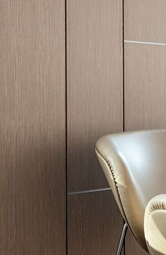 Ecoustic Veneer acoustic panel with timber aesthetic in colour Eucalyptus, close up with panel shadow lines and aluminium framing.