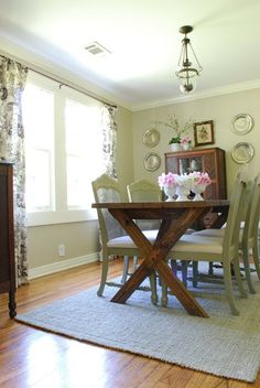 I love this website. They have before and after pics of every room of their house, and DIYs. Everything is so cute. I love this mix of a DIY rustic table in a formal dining room.