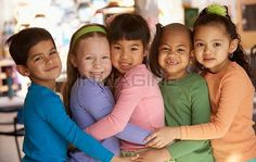 Group Of Young Children Hugging Stock Photos / Pictures ...