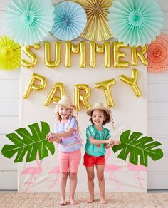 Loving this adorable pool party photo booth set up.