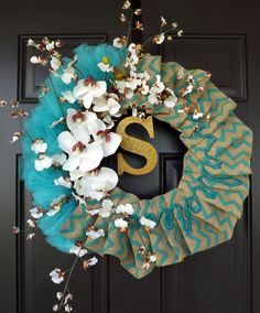 "Wreath teal color, burlap, letter S, Tulle Ribbon, White flowers - Great GIFT!. This beautiful wreath is made on a 14"" straw wreath base and measures between approximately 22"" in its shortest diameter and approximately 23"" in its widest diameter, ribbon to ribbon and 5"" deep. This wreath is just GORGEOUS !!! Must see to believe! The picture just can't tell it all! All my wreaths are hand made by me. I never repeat myself, so be sure you are buying a one of a kind, unique, piece of home..."