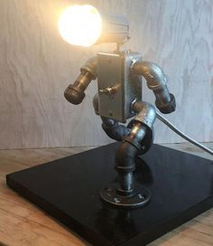 Items similar to Robot lamp (the walker) on Etsy Industrial Robots, Industrial Design, Desk Lamp, Table Lamp, Acoustic Panels, Pipe Lamp, Custom Wall, Lamp Design, 1 Piece