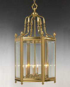 Style#LL-6a-Cast brass and glass hexagonal six light lantern. Shown in standard gold brass finish.