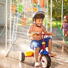 Whether children ride or run through this sprinkler, they'll have fun pretending they're at a real car wash.