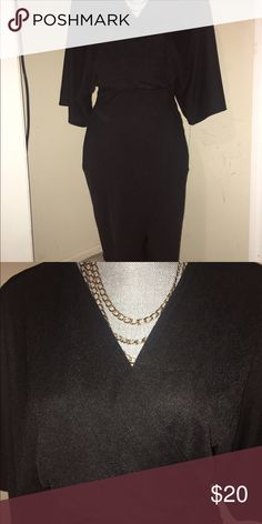 Black wrap dresd NWT- Black dress from ASOS -US size 4 /UK size 8- this dress does not tie, it is a slip on dress with a high slit ASOS Dresses Midi