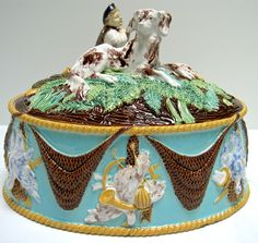 Extremely rare, possibly unique, George Jones Game Dish with Boy and Hound finial. Majolica International Society image from the Karmason Library.