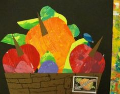 "second graders created ""Market Day"" fruit crates. The project took three 45-minute sessions. First session: the students created their own painted paper.  Second session: students free-cut (organic shapes) fruit and vegetables.  Third session: they created a wooden crate from brown paper, added a colorful border and glued all the pieces together."