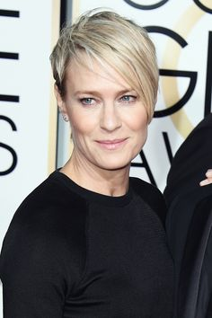 12 Celebs Who Proved Short Hair Rules On The Red Carpet #refinery29 http://www.refinery29.com/2015/01/80609/short-hair-trend-golden-globes-2015#slide-12 Sleek and sexy as always, Robin Wright's pixie cut, styled by Paul Norton, was the stuff of magic. Her piece-y bangs added great texture to the otherwise slick style.