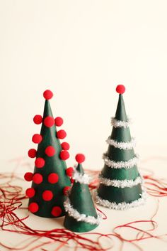 These miniature trees will add contemporary Christmas cheer to your collection of traditional decorations. Make a run to the craft store for a few supplies, and then build this festive decorations in almost no time at all. Click through for a tutorial and more DIY Christmas table decorations and table settings.