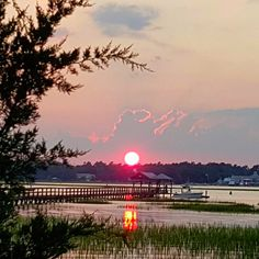 View at Sunset from Gulfstream Cafe in Garden City, South Carolina.   (Photo via Instagram by @stewartbuzz - Click on the pin when you are ready to see additional places for waterfront dining in the Myrtle Beach, SC area.)