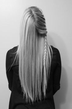 Interesting quarter-head falling French braid. Would look just as lovely with the other half done up similarly.