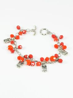 "Bracelet 1573 - This bright and happy example of ""Hoot Couture ""is perfect for a casual outfit. Adorable antique silver owl charms are paired with cherry red and orange faceted Czech dangling beads."