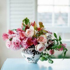 A simple arrangement with hollyhock, bougainvillea, potato vine, tomato, and garden rose