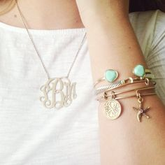 A monogram necklace and Alex and Ani bracelets!
