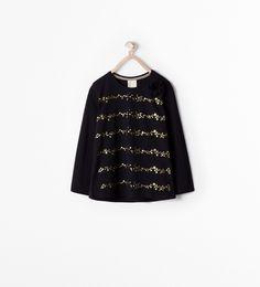 Image 1 de T-SHIRT BANDE ÉTOILES ET POMPON de Zara