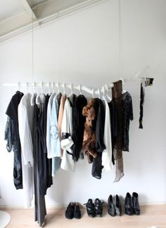 Clothes as Home Décor: Would you do it? | Free People Blog white painted branch clothes rack