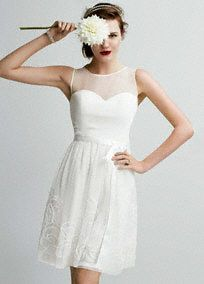 Short, airy and sweet: this wedding dress draws romantic appeal!  Sleeveless bodice features ultra-feminine illusion mesh sweetheart neckline and keyhole back.  Soutache detail skirt is eye-catching and adds texture.  Bow sash helps define the waist.  Fully lined. Back zip. Imported polyester. Dry clean only.  To protect your dress, try our Non Woven Garment Bag.