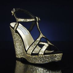 SASHA 559 by TOUCH UPS is a modern gold evening shoe with a sturdy wedge heel. Featuring a heavy glitter overlay and a black fabric trim, the Sasha is sure to look glamorous with many outfits. This open toe platform is also available in silver. $58 promshoes.com Gold Prom Shoes, Gold Evening Shoes, Wedding Shoes, Metallic Shoes, Silver Shoes, Bridesmaid Shoes, Black Fabric, Wedge Heels, Open Toe