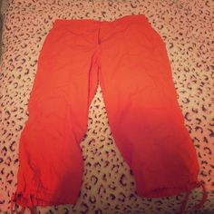 Orange capris Cuffed capris with ties at the bottom, button off in back pocket New York & Company Pants Capris