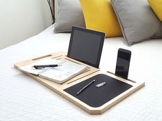 LapPad Mobile Desk. It offers you a unique lap desk that provides a place to view any combination of your iPad, iPhone and laptop all in one place.  In addition, it also includes a convenient mouse pad that doubles as a writing station.