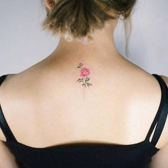 Pink peony tattoo on the upper back. Tattoo artist: Sol Tattoo
