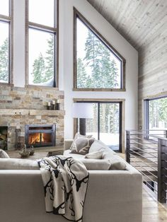 A dated A-frame cabin in Lake Tahoe is updated with a monochromatic palette. Living Room, Sofa, Coffee Tables, and Sectional In This A-Frame Cabin Makeover, Simplicity Is Key - Photo 1 of 5 - Modern Cabin Interior, Home Interior Design, Modern Cabin Decor, Modern Log Cabins, Dream House Interior, Interior Plants, Plan Chalet, A Frame House, Cabin Homes