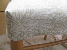 Want to dress up an otherwise out of date or worn chair cover? Instead of replacing the cover, slipcover it! Learn how with this step-by-step tutorial!