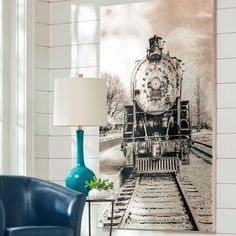 The statement-making power of our Freight Train Artwork is spectacular. This is a unique piece of artwork, with an overall metallic, silver-toned treatment    for a more industrial-contemporary look. This updated version of a timeless train image would look great in an updated industrial or rustic chic living    space, an office, or home bar