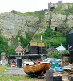 Fishing net huts, East Hill, Hastings, with the cliff funicular behind them.