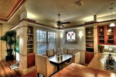 This contemporary breakfast nook retains the home's Craftsman appeal with a stained glass window and warm wood floors.