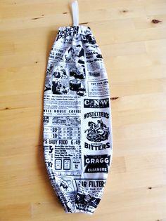 Vintage Newspaper design plastic bag holder.  http://www.etsy.com/listing/109351015/vintage-newspaper-plastic-bag-holder