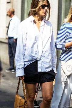 Le Fashion Blog Easy Summer Street Style Sunglasses Button Down Shirt With A Knot Tied In Front Black Skirt Brown Bag Via Sandra Semberg