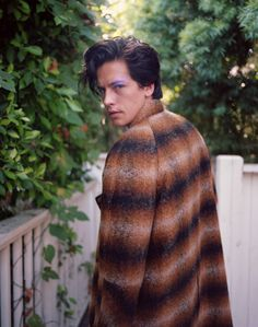 "Cole Sprouse talked about Jughead's journey in ""Riverdale"" season two and portraying male friendships on TV."
