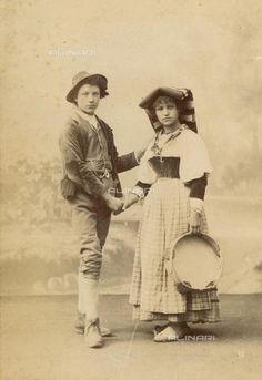 Portrait of two young people in costume typical Roman