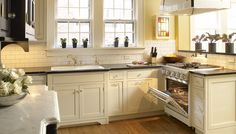 Traditional Antique White Kitchen Welcome! This photo gallery has pictures of kitchens featuring cream or antique white kitchen cabinets in traditional styles. Cream Colored Kitchen Cabinets, Yellow Kitchen Cabinets, Custom Kitchen Cabinets, Kitchen Colors, White Cabinets, Kitchen Yellow, Cream Cabinets, Yellow Kitchens, Custom Cabinetry