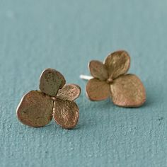 """Cast from delicate hydrangea blooms, these stud earrings pair shimmering tones of copper and antiqued bronze. Designed and hand-crafted in New York by Michael Michaud.- Bronze, antiqued metal and copper finishes- Clean gently with soap and water- Handmade in the USA0.5"""" diameter"""