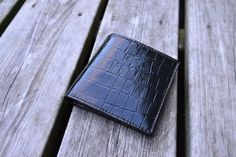 Check out this item in my Etsy shop https://www.etsy.com/nl/listing/279879902/leather-wallet-black-crocodile-embossed