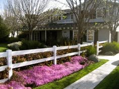 A painted white mortised fence, one of the more popular designs for homes in the suburban United States. This type has a more polished look than traditional rough hewn split rail fences, but still has a decidedly country style to it.