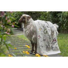 """See the entire animal alphabet series in this decorative quilt. Embroidery on 100% linen. Fine polyfil padding. Backed with 100% linen. Measures 32"""" x 50"""". Please see our detailedcareinstructionsin ourFAQs."""
