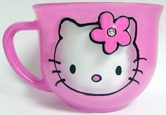 hello kitty inspired coffe mug with pink shimmer background