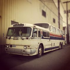 Old country music style tour bus turned homeless shelter.