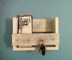 This amazing rustic wooden key holder and mail organizer is made from reclaimed wood (mostly pine) that I have painted and distressed. This will look great in your entryway, mudroom or kitchen. It measures 12 x 8.25 x 4.25. It is handmade and carefully sanded and finished. It has 4 hooks for keys and plenty of room for mail.
